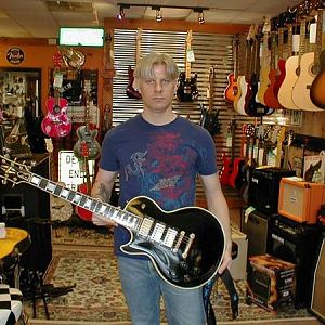 A lefty 1959 Les Paul Custom... not mine, but I played it!  An ultra rare guitar.  I'm actually very happy, the camera just caught me in between smile
