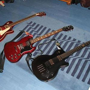The 3 of my kids. (Tanglewood Les Paul Standard, Epiphone SG Standard, Gibson Les Paul Menace)